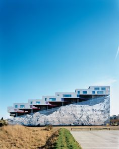 Completed in 2008, the Mountain Dwellings is the second of BIG's three projects in Ørestad, a new neighborhood in Copenhagen where development is attracting many new inhabitants. The result does looks like a mountain—hence the building's name and the inspiration for the mural of Mount Everest that adorns the 82-foot-high facade.  Photo by Jens Passoth.