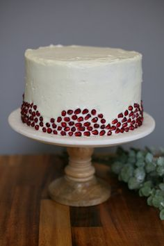 Natural red velvet cake made with beets// decorated with pomegranate seeds//