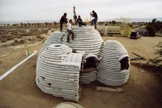 Sandbags are filled with sand and earth and stacked to form walls. Cal-Earth Institute has designed housing for locations ravaged by war or natural disasters. They have looked towards traditional earth brick buildings as inspiration for these structures.