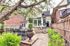 How could I possibly resist this gorgeous 1911 period home? Turns out I'm not the only one who fell in love with this beauty.Right from first glan. Toronto Houses, Toronto Condo, Etched Glass Windows, Selling Real Estate, Wood Trim, In Law Suite, Best Investments, Sloped Ceiling, Large Windows