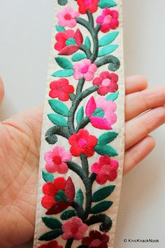 Off White Fabric Trim With Floral Embroidery, Mauve, Pink, Red And Green Trim…