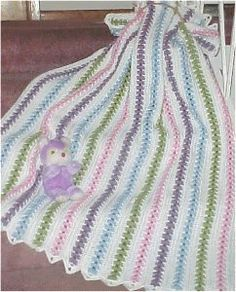 If you're looking for a baby blanket full of vintage charm, then you will definitely need to check out this Popcorn Pastel Crochet Baby Blanket.