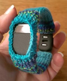 Free Knitting Pattern for Fitbit Cover - Dress up your activity wristband with this knit cozy. Great use for scrap yarn. Fits Fitbit charge or force. Designed by Janine Steingasser