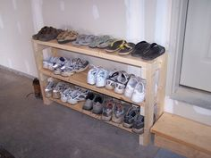 SHOE RACK in garage idea??  Maybe el Hubs can make it narrower and bring it taller so the top can be shelves and dog food area as well?