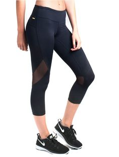 Knock them out with our best selling tight. With sheer mesh panels across the back of the knees, you'll look as amazing going as you did coming. We love the slick nylon fabric that holds you in while