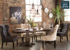 Plush upholstered side chairs provide luxurious seating making it easy to spend countless hours relaxing and entertaining around the Diego table. Visit our home inspiration page and see more dining rooms. #StyledbyJeffLewis