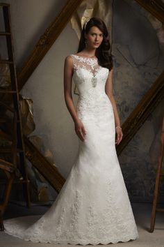 Blu by Mori Lee  Lacy, figure-hugging and utterly magical... This gown would be perfect for a traditional summer wedding.