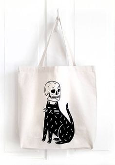 This is a super roomy tote bag has been hand printed with black water-based ink onto sturdy 12oz, natural coloured canvas. Each bag measures approximately: 14 x 17 4 gusset 22 inch woven handles Each tote has been printed by hand and may vary slightly from the one shown above. All