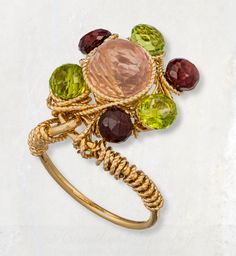 A classic arrangement of color and light, this 14K Gold Filled Hand Forged Ring reveals your beauty for all to see. Handmade with Rose Quartz, Peridot, Garnet, 14K Gold Filled Wire. Item GFR020 found on Etsy at  https://www.etsy.com/listing/215741711/rose-quartz-peridot-and-garnet-14k-gold
