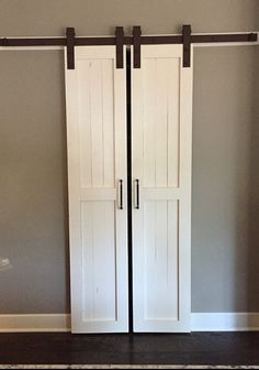 Price is for both doors!!  **Please read shipping info before checking out**  All sliding barn doors are custom made to YOUR dimensions. We do not keep any size doors in stock. All you do is provide us with the dimensions of the door you need and we take care of the rest.   Doors can either be painted/stained any color or they can be ordered unfinished. We use Behr Marquee Ultra Pure White paint exclusively on all of our doors. There is a $25 up charge for any other paint color. When…