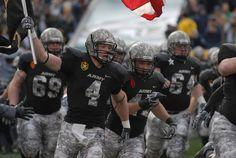 Army Football -- camouflage helmets, numbers and pants, black jerseys.