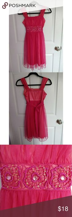 Pink Tulle Children's Dress Cute formal pink girl's dress--overlay is hot pink tulle, underneath is coral satin. Beaded trio of floral details at waist, ties at back. Size 12, My Michelle brand, great condition My Michelle Dresses Formal