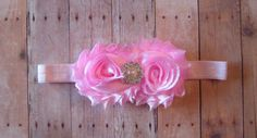 Pink Shabby Chic Fabric Flower Headband with a little piece of Sparkly rhinestone bling in the center. Flowers measure about 3 inches across . The headband is a pink soft satin stretch elastic headband but can be made in other colors if needed. Flowers are backed with felt for comfort.