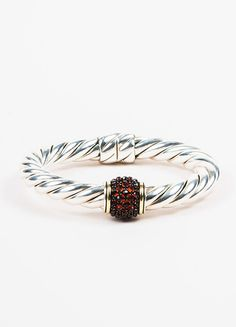 """Elegant David Yurman bangle with a garnet accent. A perfect choice for stacking or wearing alone for a little sparkle. From the """"Osetra"""" Collection. Sterling silver cable band with 18K yellow gold tri"""