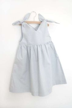 A classical girls dress shape from the love our Rabbit Dress!Knotted on the shoulder with a teardrop detail in the back.Pale grey cotton with tiny cream dotsMade with love in Germany Baby Girl Fashion, Toddler Fashion, Toddler Outfits, Kids Outfits, Kids Fashion, Latest Fashion, Fashion Shoes, Little Dresses, Little Girl Dresses