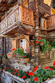 Red geraniums potted around this log cabin Alpine Chalet, Swiss Chalet, Wonderful Places, Beautiful Places, Alpine Style, House Doors, Log Homes, Beautiful World, My Dream Home