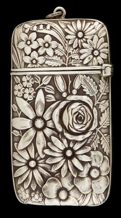 (This is one of my favorite pieces, I just love it! JVB) Whiting sterling silver match safe, 1890s.