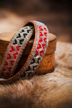 The sami people have a long tradition of using pewter to decorate their garments and make jewlery. Pictured here is leather and pewter braclets. Photo by; Jessica Lindgren