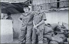 Women's Army Corps (WAC) Staff Sergeant Carol A. Ogg, a member of the U.S. Army 509th Radio Research Group, and Specialist Fifth Class Jo Wilson in front of the Medford Bachelor Enlisted Quarters, Saigon, South Vietnam, 1970. Sergeant First Class Carol Ogg photo.