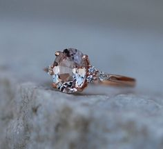 Jaw-Dropping Sapphire Engagement Rings For The Modern Bride ~ so unique! Moody sapphire engagement ring set in 14k rose gold and accented by 2 round and 1 pear diamond on each side of the center stone by EidelPrecious