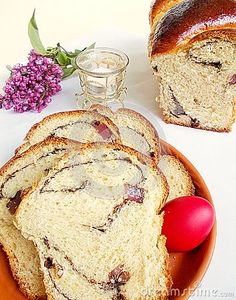 Photo about Traditional Romanian Easter sweet bread named cozonac. With red egg on a plate and a candle. Image of named, bakery, celebration - 111821344 Sweet Bread, Bakery, Egg, Easter, Plates, Candles, Stock Photos, Traditional, Food