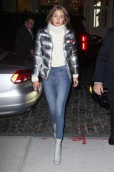 Gigi Hadid, silver Hillfiger bomber, chunky knit, high waisted jeans, gray patent boots, kind of obsessed.