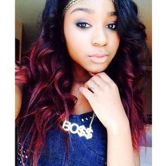 "Amazing accessory alert! Normani Hamilton showed off a gorgeous selfie where she's showing off an incredible ""BO$$"" necklace. We also love her fiery hair and colorful eye makeup in the stylish pic."