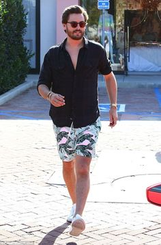 Floral: The 32-year-old wore a pair of floral shorts and a black button-down...