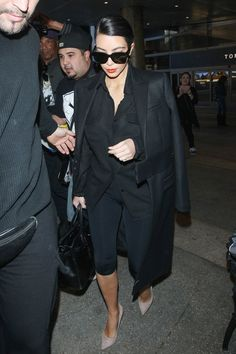 Kim proves you can't go wrong in all black. Tired too? Throw on some shades.    - ELLE.com