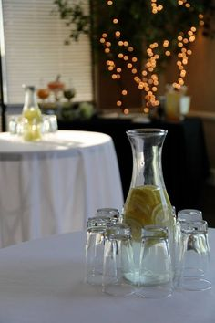 Alcoholic drinks and non-water at drinks table, water carafes on table Flavored water carafes as centerpieces. Water Carafe, Best Party Food, Centerpieces, Table Decorations, Drink Table, Brunch Ideas, Best Part Of Me, Tablescapes, Alcoholic Drinks