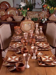 More Good Earth Pottery. We love the monochromatic look of this table setting.