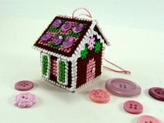 This  #gingerbread  house  #ornament  really puts your needlework skills to the test.