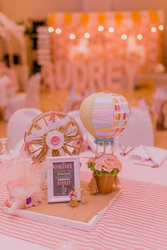 Cute carousel table top decoration and sign