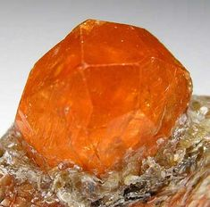 Complete orange Spessartine crystal, 13mm wide, set in bright, silvery green mica. Super quality and one of the top for the find. Garnet has sharp crystal faces with no black inclusions and bright citrus orange color. Size 2.7 x 2.4 x 1.5 cm.