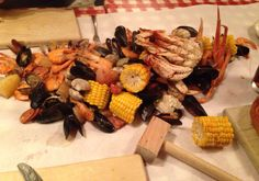 Crab Feast poured onto a butter covered table. Crab Pot, Seattle, Washington