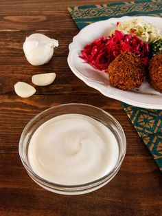 Toum - Recipe for Arab Garlic Dipping Sauce. Use on Shawarma, Falafel, Grilled Foods. Vegan, Garlicky, Creamy and Flavorful. via @toriavey