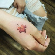 Maple Leaf Tat - http://www.tattooideas1.org/placement/hand/maple-leaf-tat/