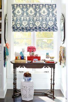 styled window nook, ikat roman shade, antique table, garden stool