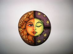 Hand painted stone moon & sun by Lefteris Kanetis