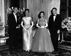 ROYALTY  QUEEN ELIZABETH AND PRINCE PHILIP HOST A QUEEN'S DINNER FOR PRESIDENT AND MRS. KENNEDY AT BUCKINGHAM PALACE ~ JUNE 5, 1961