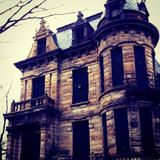 Franklin Castle makes a spooky first impression with its sandstone exterior, round corner tower and gargoyle embellishments, it is also locally known as the most haunted house in Ohio; read more on FrontDoor.com. | HGTV FrontDoor