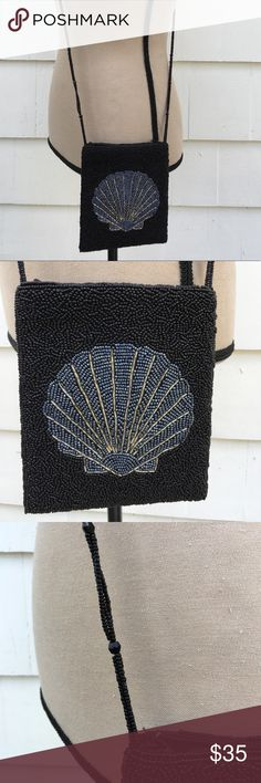 """Black Beaded Evening Cruise Blue Sea Shell Bag Black Beaded Small Evening Purse Special Occasion Cruise Blue Sea Shell Bag  Beautifully beaded throughout purse. Can be worn as a shoulder or cross body bag. Strap is also beaded. Zipper closure.  Strap drop 23""""  Wide 6""""  Length 7""""  Absolutely pristine condition. Worn only one time for a total of 4 hours. Clean and missing no beads. Near new ! Bags"""