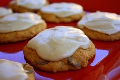 pumpkin chocolate chip cookies with brown sugar icing.