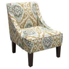 Ikat-upholstered swoop arm chair with a pine wood frame and foam cushioning. Handmade in the USA.  Product: ChairConstruc...