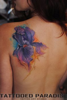 Iris watercolour tattoo. I would get this on my chest though, not my back. Same side too