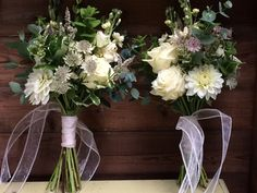 Bridesmaids bouquets with dahlias and ivory roses
