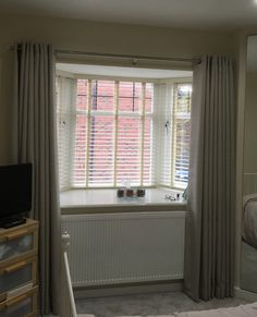 full length eyelet curtains using an Ashley Wilde fabric & curtain poles from price & company