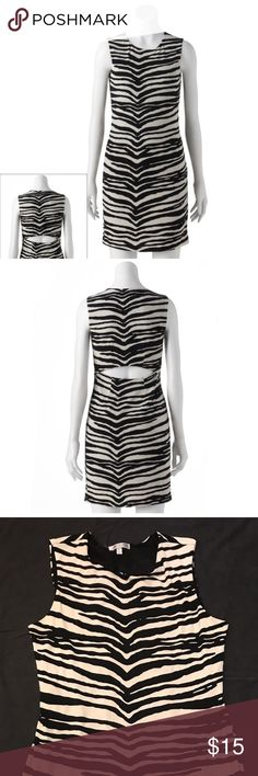 Women's Jennifer Lopez Zebra Bodycon Dress PRODUCT FEATURES Zebra print Cutout lower back Crewneck Sleeveless Full lining FIT & SIZING: 35-in. approximate length from shoulder to hem FABRIC & CARE: Dress: polyester/spandex Lining: polyester Machine wash Imported Jennifer Lopez Dresses