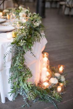 Sweetheart table with garland and candles. Calamigos Ranch Malibu Wedding | Miki & Sonja Photography | www.mikiandsonja.com