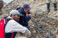 University of Alaska Museum of the North examining Cretaceous rock along the Yukon River (Credit: Pat Druckenmiller)